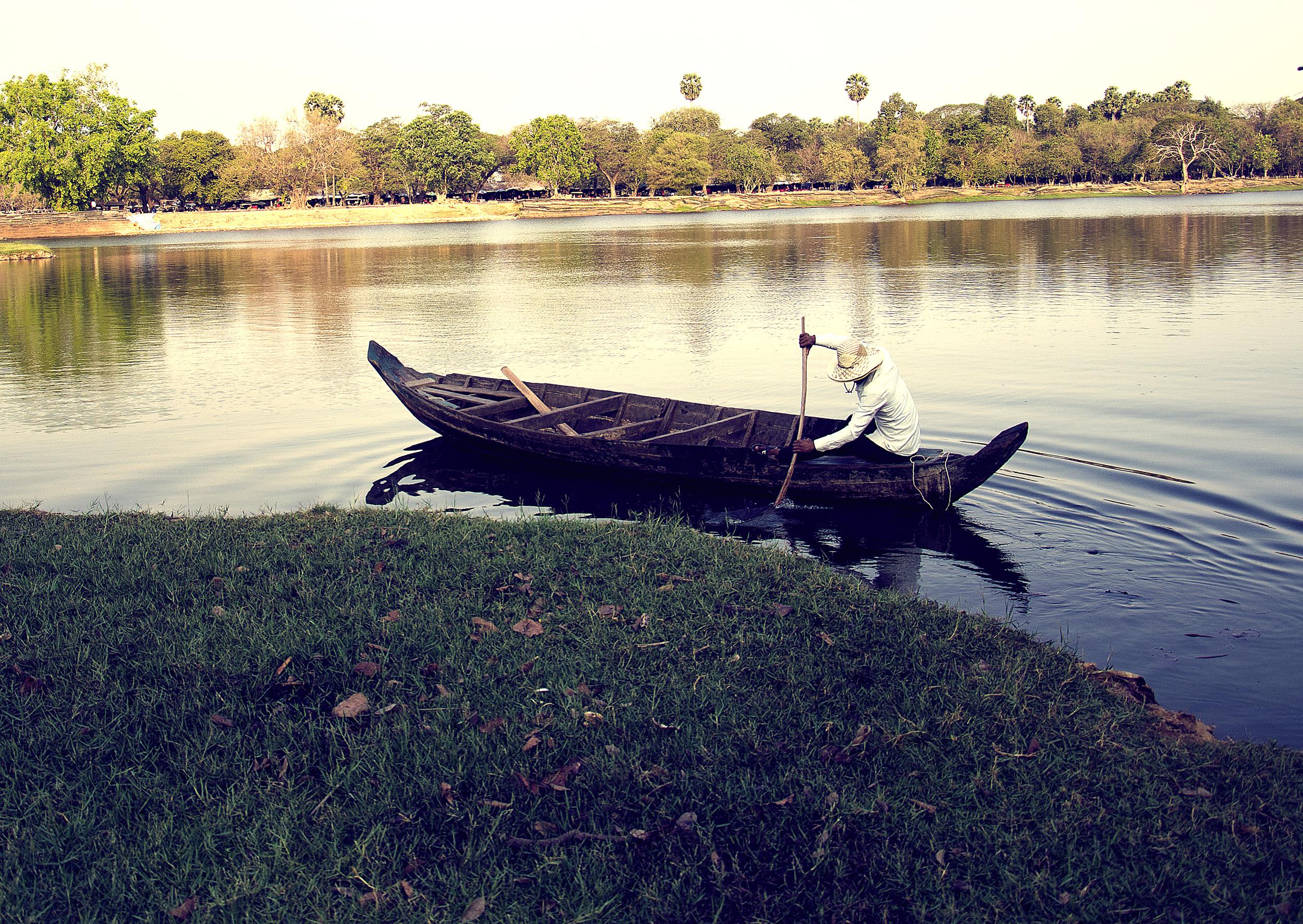 A dugout canoe ride across Angkor Wat's Moat!