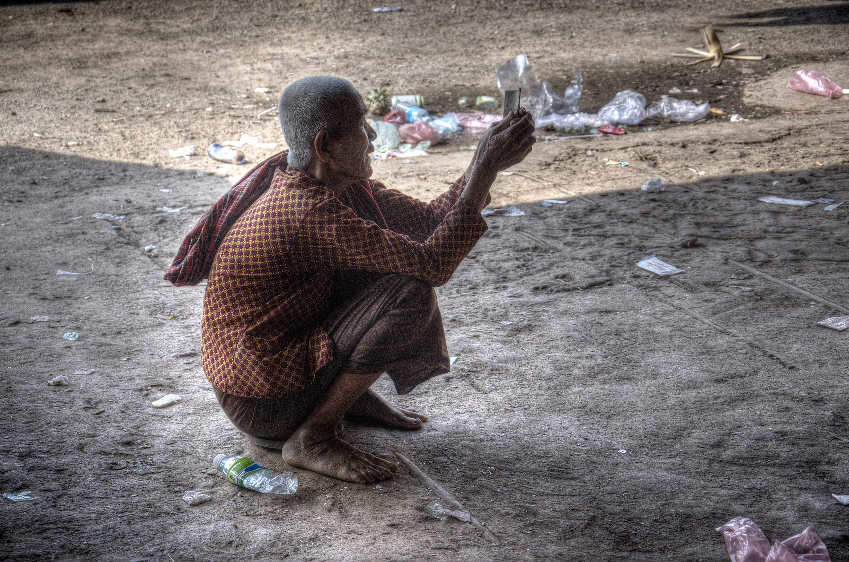 An old widow begging for food and money in Kampong Cham Province, Cambodia