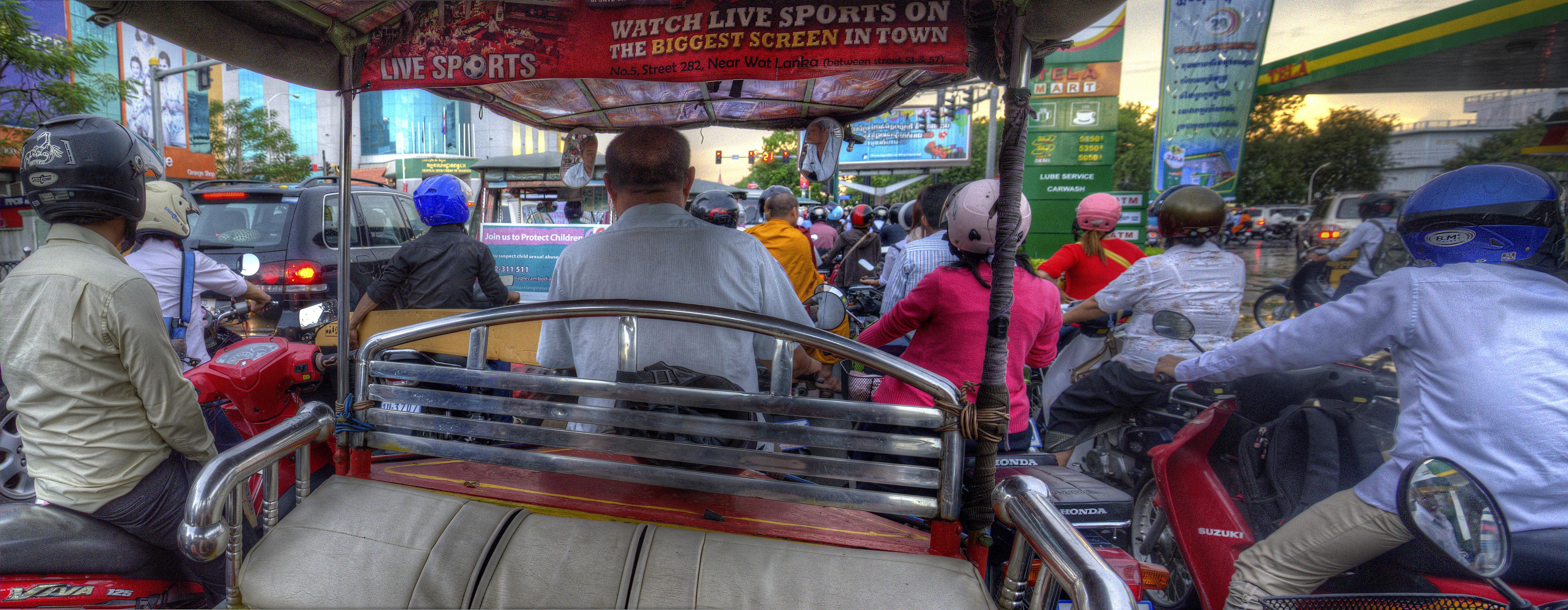 View from a Tuk Tuk at a traffic light; Phnom Penh