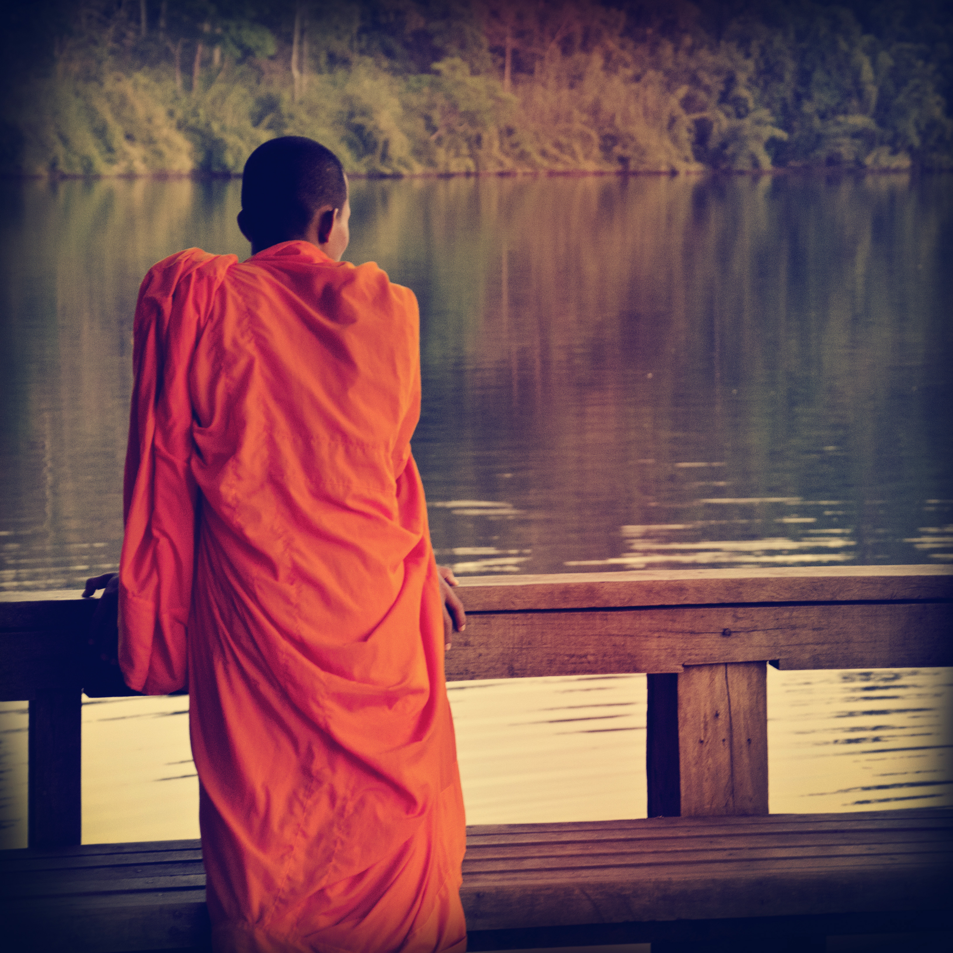 buddhist monk in cambodia, looking at the view