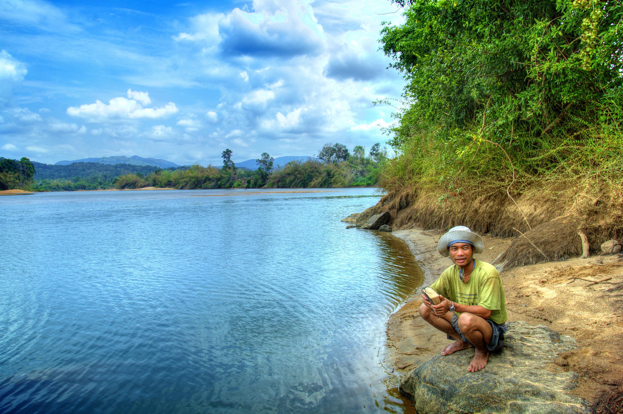 Brao man on the banks of the Sesan in Ratanakiri, Cambodia